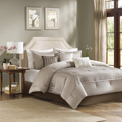 Madison Park - Madison Park Trinity 7 Piece Comforter Set - The Madison Park Trinity Collection provides a modern look through fabric manipulation. This beautiful taupe polyester charmeuse gives a slight sheen to this bed while the small pleating on the bottom half of the bed and corresponding shams provides great dimension for your room. Three decorative pillows use embroidery and pleating to bring this beautiful collection together. Comforter & Sham: 100% polyester charmeuse, 100% polyester brushed fabric reverse, 270g/m2 poly fill Bedskirt: 100% polyester charmeuse drop, 100% polyester platform Pillows: 100% polyester shell, polyfill