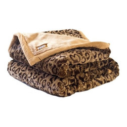 "Posh Pelts - Leopard Faux Fur Throw Blanket with Cinnamon Accents and Camel Color Lining - When this Leopard faux fur throw blanket is tossed over your couch, the Leopard's beautiful coat is recognizable from across the room. Uncommonly beautiful, this Leopard Faux Fur throw blanket is extremely soft. Cinnamon fibers are tip dyed fawn. Brunette leopard spots are stylishly placed so that the pattern is subtle and eye-pleasing. Fibers are approximately 1/2"" (1.5 cm) and are tightly woven to create a thick soft faux pelt. The throw is backed by camel-colored short-pile faux fur, and is trimmed in faux suede the same color. It nicely accents subtlety patterned decor of brown / neutral / cordovan tones. PoshPelts faux fur pillow cover that complements the Leopard: Leopard. Features: -Throw blanket. -Content: faux fur 80-85% acrylic, 15-20% polyester: faux suede 100% polyester. -Soft, short-pile animal print faux fur front. -Edged with 1"" camel-color faux suede trim with mitered corners. -Backed with camel-color silky short-pile faux fur. -Superior quality and craftsmanship. -Extra length for added comfort. -Zippered plastic bag during shipment. -Machine wash cold; no heat dry; dry cleaning recommended. -65"" H x 45"" W, 6 lbs."