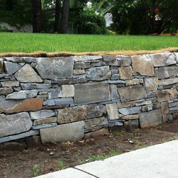 French Country Stone Retaining Wall - Montana Ledge Stone Retainer Wall by English Stone. In Minneapolis.