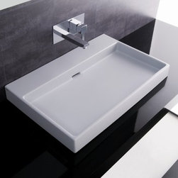Urban 70 Sink by WS Bath Collections - This ultra contemporary sink from WS Bath Collections can be mounted atop a counter or hung from the wall. It's rectangular shape and shallow basin will keep things very modern and streamlined in the bathroom.