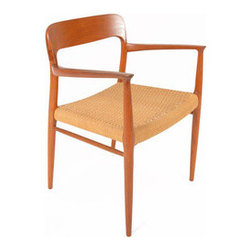 Vintage Teak Armchair - A masterpiece of Danish modern design, this armchair makes a statement wherever you decide to put it. Constructed from teak and paper cord, this vintage chair is unrestored and stunning.