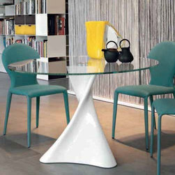 Tonin Casa - Tonin Casa | La Defense 47-inch Round Table - Made in Italy by Tonin Casa.With a twisted, avant garde base, the La Defense 47 Inch Round Table is the perfect piece for those who want to add sophistication and art to even the smallest of spaces. The artistic aesthetic of this piece is not limited to the fluid design of the base but can be seen in the fine Italian craftsmanship and choice of materials. The strong marble base is complimented by the clean lines and simple design of the glass table top which is securely mounted upon the base.