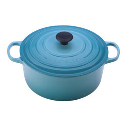 Le Creuset - Enameled Cast Iron 7 1/4-Qt. Round Dutch Oven - For generations, families have come to cherish this everyday French Oven (or Dutch oven, referred by most people). Ideal for simmering, marinating, poaching, braising, and browning; this piece moves from the stove or oven to the table and can store leftovers in the refrigerator or freezer! The tight fitting lid creates a blanket of heat, sealing in flavor and moisture, and is equipped with a phenolic knob which is oven safe up to 480 Degrees F. The Le Creuset enameled cast iron pieces evenly spreads heat and retains heat longer than other cookware materials. Features: -Dutch oven.-Material: Enameled Cast Iron.-Round shape.-Enhanced handles are 45% larger, distributes the weight evenly and easier to grip when wearing oven mitts.-Improved ergonomic knob, for easier grip, and now resistant up to 480 degrees.-Phenolic knob is oven safe to 480°F.-Lid traps heat and seals in flavor and moisture.-Works well on all heat sources, including induction and oven safe.-Ideal to use when making soups, rice dishes, casseroles, roasts, quiches, one pot meals, baked recipes, desserts, cakes and breads.-Refrigerator and freezer safe.-Dishwasher safe, but Hand washing is recommended.-Capacity: 7 1/4-Qt..-Provides even heat distribution and superior heat retention; colorful exterior enamel resists chipping and cracking.-Advanced sand-colored interior is durable, makes it easy to monitor food as it cooks to prevent burning or sticking.-Collection: Enameled Cast Iron.-Distressed: No.-Country of Manufacture: France.Dimensions: -Dimensions: 3.25'' H x 7.13'' W x 7.13'' D.-Overall Product Weight: 13.5 lbs.Warranty: -Lifetime limited warranty.