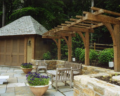 Triton Timberworks - Poolside pergola made of hand hewn Oak with an oiled finish.