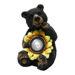 Alpine Fountains - Black Bear w Solar Sunflower Garden Statue - Made of Fiberglass. 1 Year Limited Warranty. Assembly Required. Overall Dimensions: 6 in. L x 6 in. W x 10 in. H (2.97 lbs)These cute black bear statuaries will add character to your garden, patio or home. Simply place in your garden and let it charge in the day and watch as it illuminates at night bringing life into your garden.
