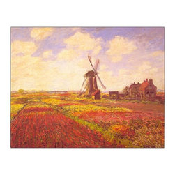Trademark Art - Tulips in a Field by Claude Monet Framed Wall - Framed canvas art. Traditional style. Subject: Museum Masters. Format: Horizontal. Size: Large. Canvas material. 32 in. W x 24 in. H (5.20 lbs.)Giclee is an advanced printmaking process for creating high quality fine art reproductions. The attainable excellence that Giclee printmaking affords makes the reproduction virtually indistinguishable from the original artwork. The result is wide acceptance of Giclees by galleries, museums and private collectors.