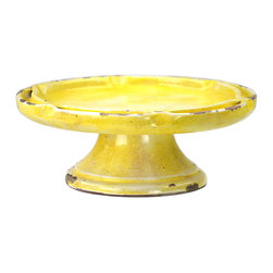"""Yellow Ceramic Cake Stand, Yellow - A bright pop of color, this yellow ceramic cake stand is a cheerful and fun accent. Perfect for serving a cake to treasured guests, this cake stand features a wide pedestal base with a double rim - with a """"pinch"""" every so often for dimension and texture. The rustic yellow finish is moderately distressed, creating an antique appearance. Not limited to serving, this cake stand would make a wonderful accent in other areas of the home as well."""
