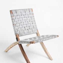 Silver Lining Chair - This chair offers big style at a not-so-big price; I love the contrast of the woven straps with the wood frame. It's also cool that the straps are made of recycled plastic rope; this makes it make you feel good about being green. Just don't sit on it in short-shorts or you'll have a woven pattern on the back of your thighs.