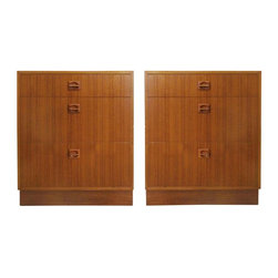 Used Danish Modern Teak Nightstands - A Pair - A pair of Danish Modern teak nightstands in the manner of Poul Hundevad. The clean lines with matched grains and inset wood handles really show off the craftsmanship of these pieces. Each nightstand has a small drawer on top and graduates in size to a large bottom drawer.