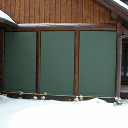 Outdoor Porch Blinds - Sunbrella's Fern Awning fabric gives this log home a beautiful green accent color while protecting the screens, porch and furnishings from the snow & wind.