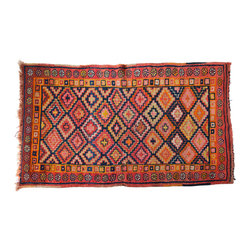 Vintage Herki Tribal Rug - The nomadic Herki tribe lives between the plateaus and mountains of Hakarri in Turkey, as well as in Iraq and Iran. Making their living through sheep and goat herding, they are famous for their well-made and hard-to-find carpets, which are hand-spun on floor looms using vegetable-based dyes. These rugs are in excellent condition, although a few have proven their usefulness through gentle wear. They are perfectly sized to throw by your bed, overlap to create a bohemian den, front hall etc. For the textile lover who strives for the unique.