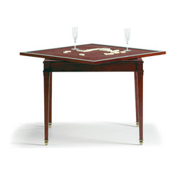 Baker Furniture - Lully Game Table - Inspired by a table in Jacques Garcia's chateau, this exquisite Game Table is a remarkable example of Baker's fine craftsmanship.  The top is a delicately patterned parquetry of cherry veneer.  When flipped it exposes its velvet, game table top.  The four-sided carved legs are slightly tapered and outlined in a slight recess carving then terminate to small acorn shaped feet.  The table, shown here in the warm, honeyed tones of Chateau is also offered in the deep, dark Rivoli finish.