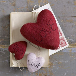 Felt Hearts - How cute would these little felt hearts be at each person's plate for Valentine's Day dinner? Or hung from your front door knob to add a subtle but festive touch to your home? They're so sweet and affordable too.