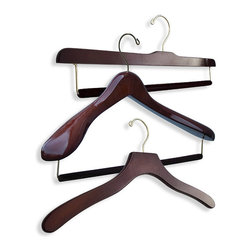"Frontgate - Men's 18-pc. Premium Hanger Collection - Designed in collaboration with bespoke tailors. Available in 100% birch wood with Bubinga finish or 100% maple wood construction with satin finish. Available in up to four different widths (small, medium, large, extra-large) for optimal sizing (15-1/2"", 17"", 18-1/2"", 20""). Suit hangers feature 2-1/2"" shoulder flare, offering up to five times more support than average hangers. Eliminates shoulder dimpling, which is caused when hangers do not extend all the way to the edge of the shoulder. Protect and extend the life of your most important wardrobe items with our Luxury Premium Men's Hanger Collection. This premier set includes three suit hangers, five felted trouser hangers with bars, and ten shirt hangers. Each shirt and jacket hanger is contoured to mimic your natural shoulder profile, preserving the garment's original tailored collar and drape. .  .  .  .  . Suit hangers and trouser bar hangers include a felted trouser bar, eliminating unsightly mid-thigh creasing caused by ordinary locking-bar mechanisms . Trouser bar hangers feature 2-1/4"" drop, which makes threading your trousers easy ."