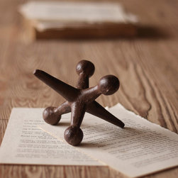 Cast Iron Jack Paperweight - For those of us who never really grew up, a desk aid that puts paper in its place and recalls the lazy days of our youth. You'll have to seek a cast iron ball on your own!