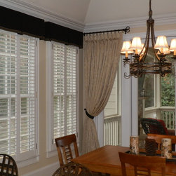 Window Treatments - Goblet pleated drapery with custom tie-back on a custom wrought iron rod with rings.  Box pleat valances over louvred windows by Encore Decor Atlanta