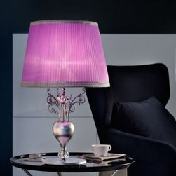 """6010/6011 TL1 Table Light - The 6010/6011 TL1 Table Light is part of a collection of High End light fixtures designed by Studio Stile Masiero in Italy for Masiero. This table lamp is a beautiful and harmonious piece that brings to classicism and modernism a new perspective. 6010/6011 TL1 table lamp is an elegant light fixture available in two sizes consisting of a base and a metal rod enriched with brass fusion decorations in chrome-plated finish. A candle-light that sits on the superior side of the rod is covered by a delicate violet colored Pongè lampshades which is optional. This is a stylish and contemporary table lamp that will light up any environment. Illumination is provided by E27 100W Incandescent bulb (not included).     .proddesc p{font-family: Verdana, sans-serif; font-size:8pt!important;}   .pdtable{font-family: Verdana, sans-serif; font-size:8pt!important;padding:10px;} Product Details: The 6010/6011 TL1 Table Light is part of a collection of High End light fixtures designed by Studio Stile Masiero  in Italy for Masiero. This table lamp is a beautiful and harmonious piece that brings to classicism and modernism a new perspective. 6010/6011 TL1 table lamp is an elegant light fixture   available in two sizes consisting of a base and a  metal rod  enriched with brass fusion decorations in  chrome-plated finish. A candle-light that sits on the superior side of the rod is covered by a delicate    violet colored Pongè lampshades   which is optional.   This is a stylish and contemporary table lamp that will light up any environment. Illumination  is provided by  E27 100W Incandescent    bulb (not included). Details:                         Manufacturer:            Masiero                            Designer:            Studio Stile Masiero                            Made in:            Italy                            Dimensions:                        Small: P: Height: 12.6""""(32cm) X Diameter: 6.3""""(16cm)             Large: G: Height: 25.6""""(65cm) X Diameter: """
