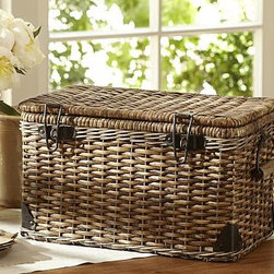 "Daytrip Lidded Split Rattan Basket, Large - Skilled craftsmanship is evident in the intricate weaving of our rattan basket, which was inspired by vintage automobile trunks. 19.75"" wide x 10.75"" deep x 10.5"" high Made of handwoven split malacca and natural rattan. Iron sheet metal with a bronze finish. Iron sheet metal hardware with a bronze finish."