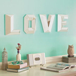 "Love Faceted Mirror - These mirrored letters spelling out ""love"" are great for warming up walls or welcoming loved ones into your home."