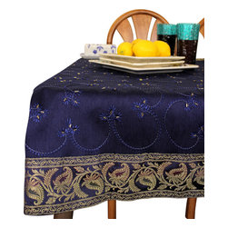 "Banarsi Designs - Hand Embroidered Rectangular Tablecloth (King Blue, 60"" X 104"") - Transform any tabletop into a display of art with the exclusive Hand Embroidered Rectangular Tablecloth from our Banarsi Designs collection. This beautiful and vibrant tablecloth is available in two sizes: 52"" X 70"" and 60"" X 104"" (inches). Crafted in India, our tablecloth incorporates hand embroidered beads throughout the entire abstract design and is available in a variety of bold colors including plum purple, coffee brown, and mystic black. Our tablecloths are ideal for decorating your tables for every occasion and also make wonderful gift ideas. Banarsi Designs Exclusive"