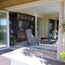 """La Jolla Series Folding Doors - A revolutionary and proprietary folding door system. Operating like a French door and offering the option of a panoramic opening. The """"La Jolla Series"""" is a high end folding door system at a reasonable price point. The dramatic impact of a wide door opening is priceless. The La Jolla Series door represents the California lifestyle. It is the best option to patio doors, sliding glass doors, french doors, bi-fold doors, lift and slide doors and pocket doors. The ground breaking single track wide-span door system is flexible and versatile with a truly innovative operational hardware that is completely concealed within the frame, producing a stunning door with clean modern lines."""