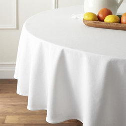"Abode 90"" Round Tablecloth - The perfect foundation for any table, our classic white tablecloth is woven for us in Portugal of 100% cotton, pre-washed for extra softness."