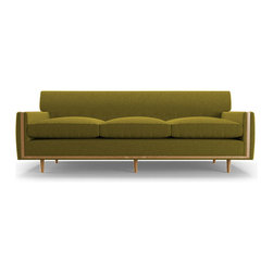 Joybird Furniture - Madsen Sofa - Key Largo Grass Green - The simple design of this 1950's throwback celebrates mid-century trends. Play with the sofa's symmetrical lines by pairing it with the movement of our Law Rug.Square wood inlay and button tufting create a lovely vintage look. The Madsen Sofa's time-honored retro design makes decorating easy; it'll look good anywhere.Our wood is available in a variety of different stains. Pick one that ties in with the rest of your furniture.Frame: Kiln dried hardwood. Once assembled, frames are wrapped in 2lb foam exceeding industry standards. Made with responsibly-sourced wood. Legs: Solid beechSuspension: Seat - zig zag springs. Back - poly webbingJoints: Glued, stapled and screwed to ensure frame stability and longevity.Assembly: Screw on legsStyle: loose seatCushions: Contain no flame retardants or harmful chemicals. Glue and Stains: Water-based, low-VOC