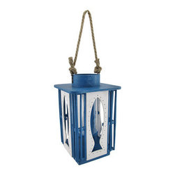 Cutout Blue and White Fish Candle Lantern - Ahoy! Reel in this nautical themed lantern! From its blue and white distressed painted wood, to the fun fish cutouts, it`s sure to be the high `light` of your home! It measures 10 7/8 inches tall, 5 5/8 inches across (7 7/8 inches across at its widest point) and has an 8 inch twisted rope handle. The 7 inch tall glass cylinder can hold up to a 2.5 inch diameter candle. It easily accommodates tea light, pillar or stick style candles. Also, looks like you`ve already caught one! A whimsical white fish dangles from the handle. Don`t worry, this one won`t get away! The perfect accent for a beach house! Or use it to light up the bathroom so your guests are never in the dark!