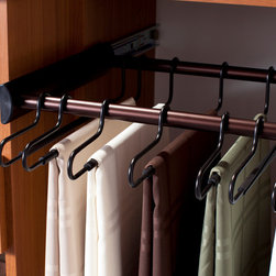 Pant hanger - A slide-out pant rack s repurposed to hang tablecloths and other linens to prevent wrinkles.