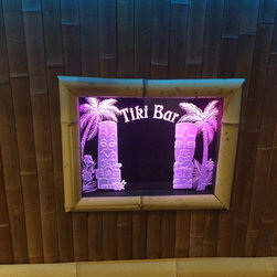 """Tiki Bar - Accessories included - Thatch Roof, Bamboo Siding, Bamboo trim and storage doors with two storage drawers. Ipod hook up for marine speakers with volume control, LED lighting under bar and in roof of bar with Tiki Glass etched sign. Concrete Overlay counter tops, 4"""" Caster wheels for mobility. All powered on a deep cycle marine battery so it can be moved to the party."""