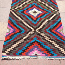 Vintage Turkish Kilim Diamond Rug by Pergamon Pillow - I like the idea of layering a few small kilim rugs together in a larger seating area in a living room. It's a perfect solution for a tight budget, as 8- by 10-foot rugs can give you sticker shock.