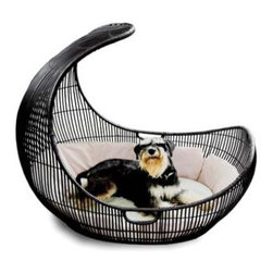 Voyage Pet Bed, outdoor By Kenneth Cobonpue - Now this is one lucky puppy. This pet bed is stylish and is perfect for indoor or outdoor pets. I love the overall design and shape of this doggy bed. I do think that it's one lucky dog who gets to roost in one of these.
