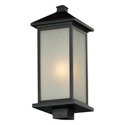 One Light Black White Seedy Glass Post Light - Clean, straight lines and rectangular detailing define the classic styling of this large outdoor post head. White seedy glass panels create an elegant glow, while the cast aluminum hardware finished in black can withstand nature's seasonal elements.