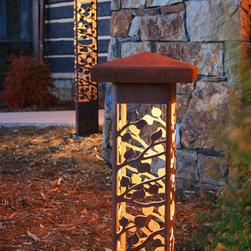 Attraction Lights overview - Aspen 6x6 Bollards, natural rust finish.  Cornerstone Resort, Colorado.  Photo by Lyle Braund