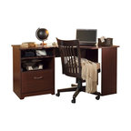 """Bush - Bush Cabot Corner Computer Desk in Harvest Cherry - Bush - Computer Desks - WC3141503 - The Bush Cabot Collection Corner Desk is the perfect solution for the tech-savvy office. The desk is designed to offer a wide-open 60"""" of work space with everything you'll need to stay connected and clutter-free, including a charging station, an open cubby that doubles as a bookshelf or modem storage area, a filing drawer, and wire management system. Designed for years of use, the Cabot Corner Desk features full-extension ball-bearing drawer slides and a beautiful, durable Harvest Cherry finish."""