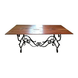 Antique French Wrought Iron Farm Table - Antique wrought iron table in great condition. Top piece and bottom piece come apart. The iron is very heavy and will look great placed in a comfy, cozy, country kitchen.