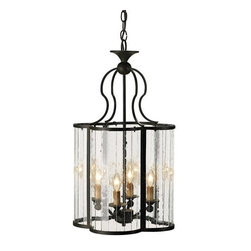 Currey and Company - Currey & Co Rupert Lantern - Curved multi-panel glass sides form a cloverleaf design in this unique piece. The wrought iron frame is finished with the Old Iron finish.