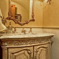Mediterranean Powder Room by Gelotte Hommas Architecture