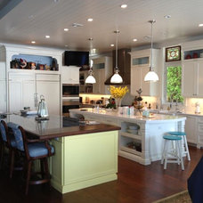 Tropical Kitchen by NMB Custom Homes and Renovations, LLC