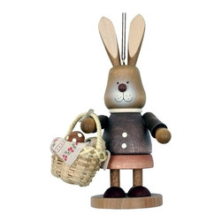 """Alexander Taron - Christian Ulbricht Ornament - Bunny Painting Eggs - 4.75""""H x 2.75""""W x 2.5""""D - Christian Ulbricht hanging ornament - bunny girl with basket in natural wood finish - made in Germany."""