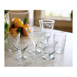 "St. Remy Mixed Glasses - Let go of preconceived notions of what the ""right"" glass is, and use a charming mishmash for everything from water to wine. Bonus: If no two glasses are alike, your guests will always remember which is theirs!"
