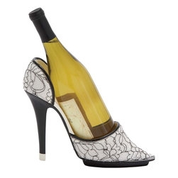 Benzara - Shoe Wine Holder with Beautiful Animal Print - Having a well thought design, this polystone wine holder is crafted to furnish your bar with a country tavern look. If you are an admirer of country side watering holes, then this polystone wine holder is an apt addition to your bar. This exquisitely designed wine holder is well spaced and can accommodate enough bottles. The flat board at the back has a crude finish to augment its rustic appeal. It is a shoe shaped wine holder that adds a modern decor touch to your bar. The wine holder is equipped with a sturdy shelf with a divider and side support. This use of polystone in construction of this wine holder ensures long lasting performance. The shelf is enameled to complement the overall design. It can be mounted on the wall for ease of use. Besides, it will also add style to your wall.
