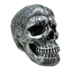 Creepy Silvered Skull Ashtray Trinket / Stash Box - Made of cold cast resin, this wickedly evil silver finished skull has a removable lid, and is perfect for storing your treasures, or for using as an ashtray. Measuring 4 3/4 inches tall, 6 inches long, and 4 inches wide, it looks quite realistic. The metallic silver and black enamel finish gives it the look of metal. It looks great on coffee tables, nightstands and desks.