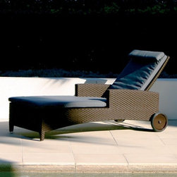 Outdoor Wicker Chaise - Outdoor wicker chaise has an adjustable back and wheels for easy positioning.