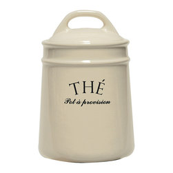 The Tea Canister - Cream-colored crockery with simple, gently-curved lines means comforting classicism in the kitchen. The Tea Canister, printed with a French message to help distinguish your kitchen containers at a glance, has an appealingly smooth lid with a traditional integrated handle which settles neatly on a cylindrical body with raised rings to give definition to the ivory ceramic form.