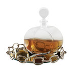 Linked Mirror Tray - Small - Adding handsome whimsy and substantial personality to a tables cape or giving a more tailored photo-ready look to your drink decanters, the Linked Mirrored Tray is a handy addition to any room. This transitional round tray with its reflective floor has walls of bright silver cable chain ringing its glassy center, both keeping the contents from sliding off and contributing a rhythmic, stark design element to a set of barware or a vanity vignette.
