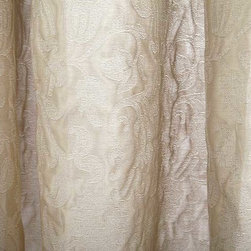 Bellefleur Sheer Floral Drapery Fabric in Chablis - Bellefleur Sheer Floral Drapery Fabric in Chablis is a cotton and silk blend in a soft monochromatic taupe shade with a subtle floral woven throughout. The floral weave gives just enough dimension to this otherwise neutral sheer drapery. The perfect fabric for window treatments or canopies, it ensures privacy while allowing light to pass through. This discount drapery fabric was made in Switzerland from 38% cotton, 36% silk, and 26% polyester. Cleaning Code S – Solvent-based cleaning agents only (water-free, dry cleaning). Width: 59″; repeat: 4″W X 17.75″H