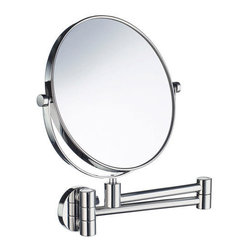 Outline Collection Swinging Vanity Mirror - The Outline Collection Swinging Vanity Mirror makes a great addition to a busy bathroom. Easily adjust the location and angle of the mirror and use the magnified side for detailed work.