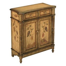 None - Orchard Antique Fruit Motif Accent Cabinet - The Orchard accent cabinet is truly a work of art. Beautifully detailed hand-painted accent cabinet in antique tan and faded green finish with fruit motif,this features two drawers,turned columns and two doors that open to a fixed shelf.