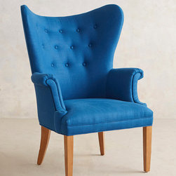 Tufted Wingback Chair - Originally constructed to block cold drafts in Colonial times, a wingback chair makes quite the historical statement in your living room. This one is inspired by an antique our buyers discovered at a Massachusetts flea market, which was then upholstered in luxurious Belgian linen.
